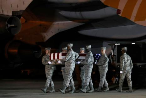 A U.S. Air Force carry team moves a transfer case containing the remains of Staff Sgt. Dylan J. Elchin, Friday, Nov. 30, 2018, at Dover Air Force Base, Del. According to the Department of Defense, Elchin, 25, of Hookstown, Pa., was killed Nov. 27, 2018, by a roadside bomb in Andar, Ghazni Province, Afghanistan. (AP Photo/Patrick Semansky)