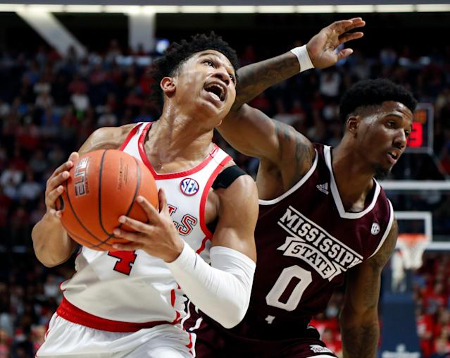 Mississippi guard Breein Tyree (4) pushes past Mississippi State guard Nick Weatherspoon (0) on his way to a layup during the first half of an NCAA college basketball game in Oxford, Miss., Saturday, Feb. 2, 2019. (AP)
