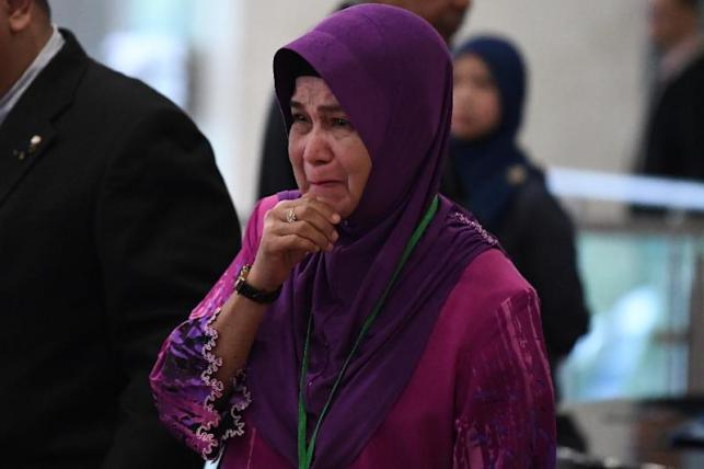 Sarah Nor, the mother of a passenger on MH370, weeps as she arrives for the final investigation report (AFP Photo/Mohd RASFAN)