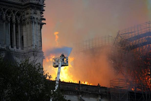 A firefighter uses a hose as Notre Dame cathedral burns in Paris, Monday, April 15, 2019. (Photo: Francois Mori/AP)
