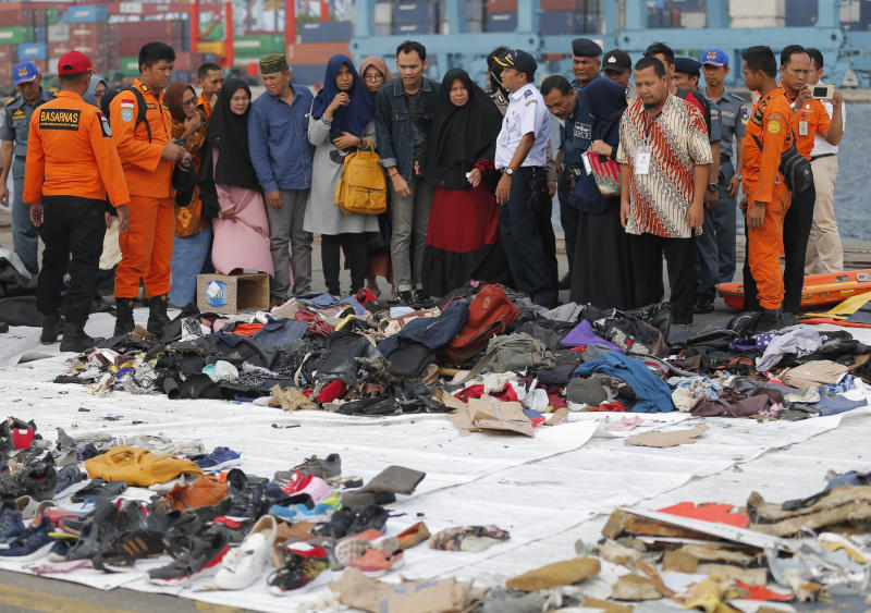 FILE - In this Oct. 31, 2018, file photo, relatives of passengers of a crashed Lion Air jet check personal belongings retrieved from the waters where the airplane is believed to have crashed, at Tanjung Priok Port in Jakarta, Indonesia. A search effort has located the cockpit voice recorder of the Lion Air jet that crashed into the Java Sea in October 2018, an Indonesian official said Monday, Jan. 14, 2019, in a possible boost to the accident investigation. Ridwan Djamaluddin, a deputy maritime minister, told reporters that the agency investigating the crash that killed 189 people had informed the ministry about the discovery. (AP Photo/Tatan Syuflana, File)