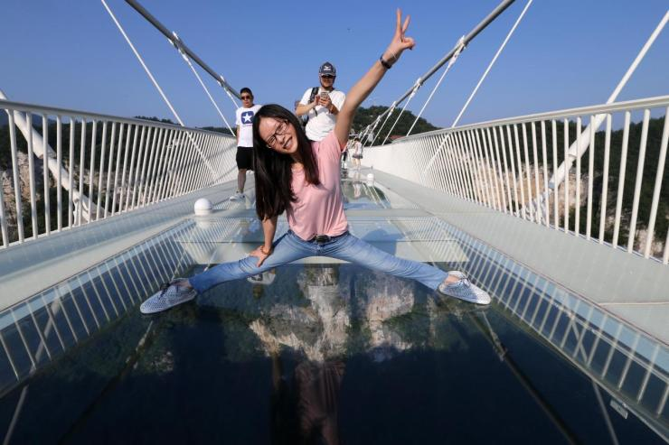 <p>The enormous structure suspends its visitors nearly 300 metres (1,000ft) above the canyon. (Getty Images)<br /></p>