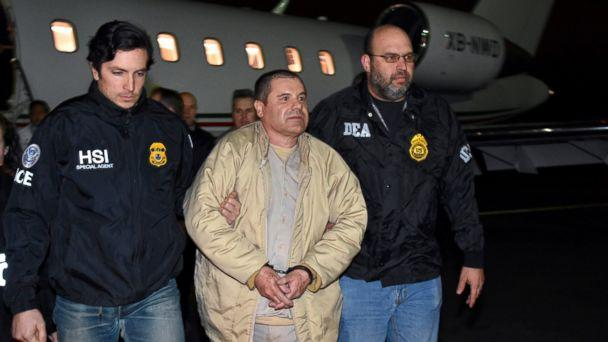 PHOTO: In this Jan. 19, 2017 file photo provided U.S. law enforcement, authorities escort Joaquin 'El Chapo' Guzman, center, from a plane to a waiting caravan of SUVs at Long Island MacArthur Airport, in Ronkonkoma, N.Y. (AP, FILE)
