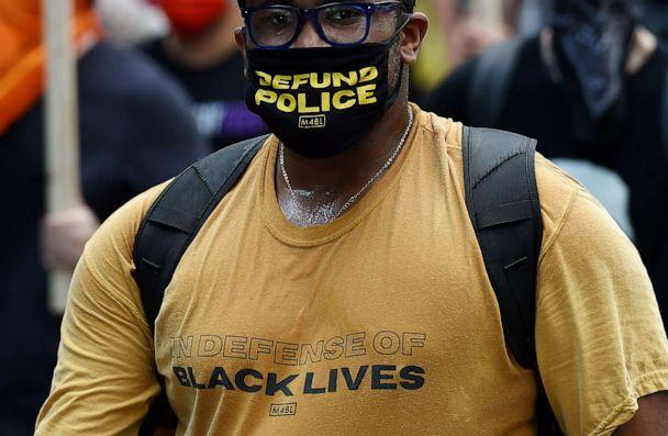 PHOTO: Demonstrators participate in a rally against 'Trump's Police State - Defend the Right to Protest' in Washington, on July 25, 2020. (Olivier Douliery/AFP via Getty Images)