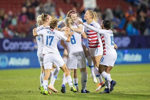 FRISCO, TX - OCTOBER 17: USA players including midfielder Tobin Heath (#17), defender Abby Dahlkemper (#7) and midfielder Julie Ertz (#8) celebrate a first half goal by midfielder Rose Lavelle (#16) during the CONCACAF Women's Championship gold medal game between the USA and Canada on October 17, 2018 at Toyota Stadium in Frisco, TX. (Photo by Matthew Visinsky/Icon Sportswire via Getty Images).