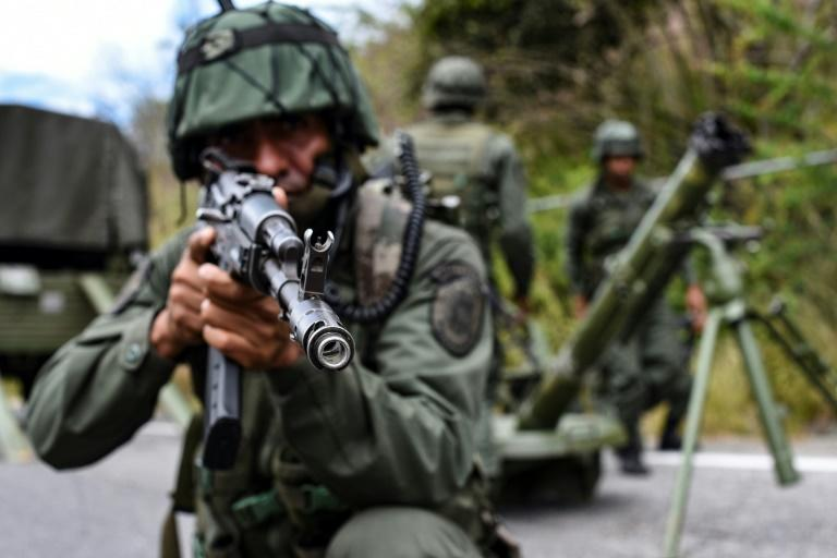 """The Venezuelan military is undertaking a massive air, sea and land search for remnants of attackers the government described as """"mercenaries"""" (AFP Photo/Yuri CORTEZ)"""