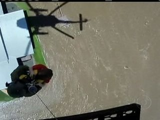 Helicopter saves child in the middle of a flooded area in Australia