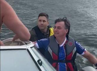President Jair Bolsonaro rides a water bike on Lake Paranoá, in Brasilia