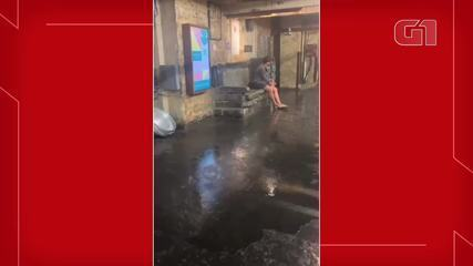 After heavy rain in Chelsea, New York, water runs off inside trade