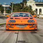 Brian S Orange Toyota Supra Digitally Races His 1995 Mitsubishi Eclipse Buster Autoevolution