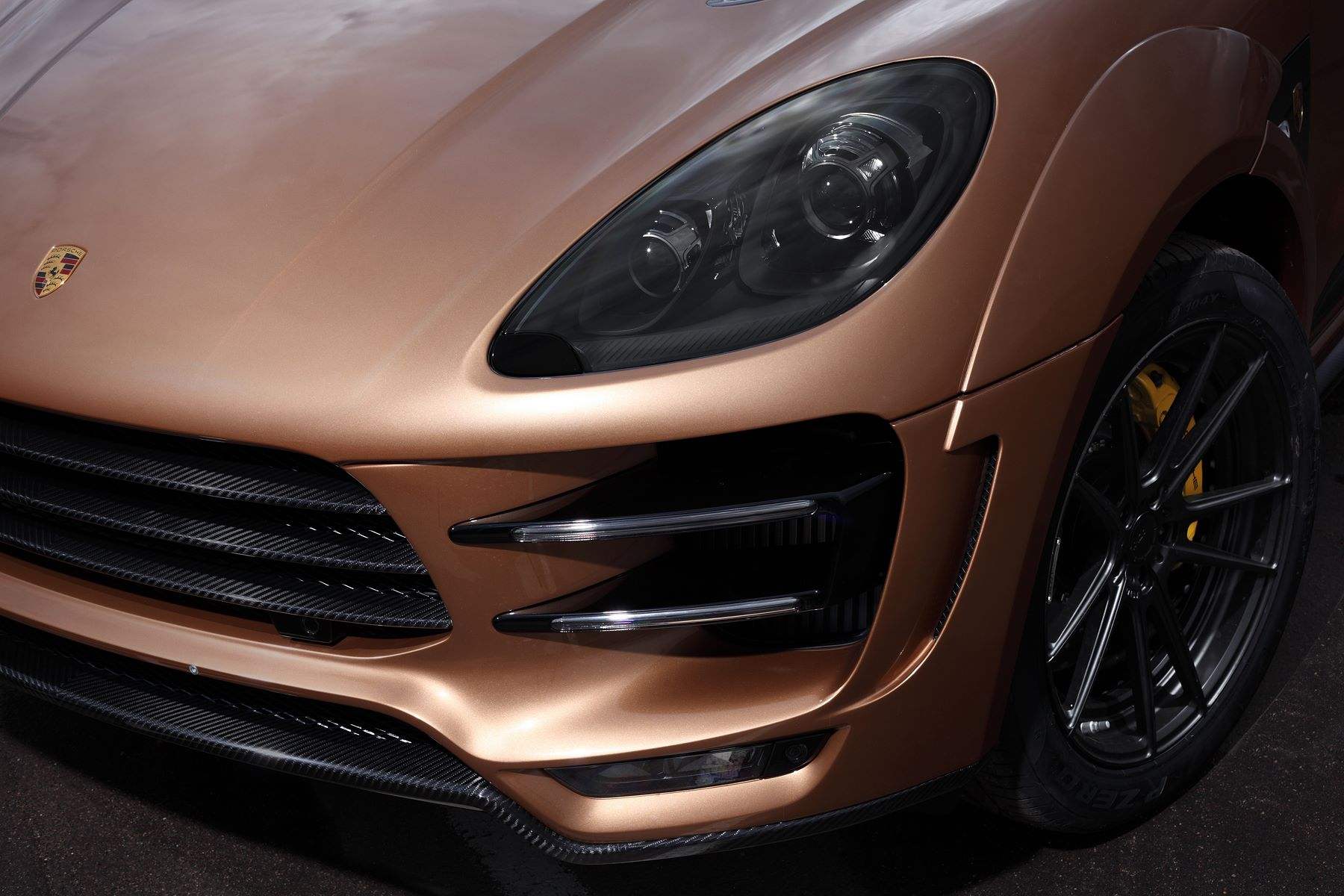 Macan URSA By Topcar Has Gold Colored Carbon Fiber And