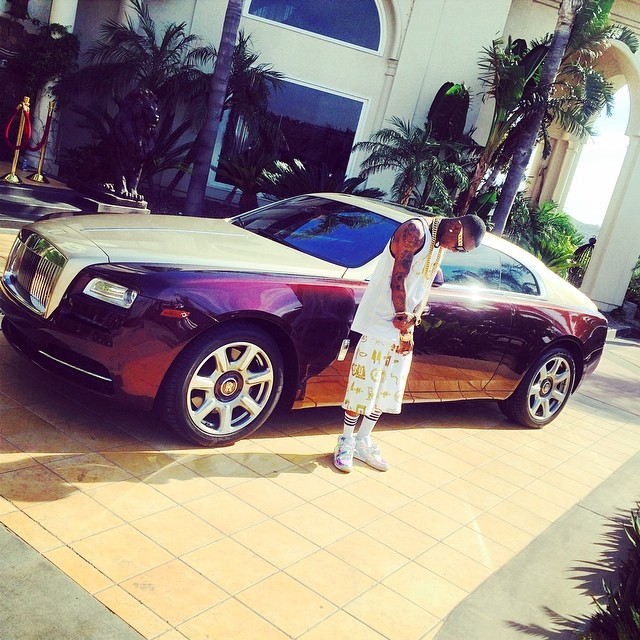 Soulja Boy Poses Next To Wraith New Ride Or New Rental
