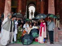 Photos: MPs with black umbrellas protest 'black money' issue outside parliament