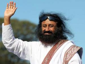 Sri Sri gives Modi clean chit on riots: Allegations are