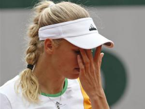 French Open: Wozniacki beaten on court after losing in love