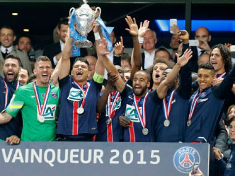PSG captain Thiago Silva, center, holds up the trophy while celebrating with teammates after winning the French Cup final.AP