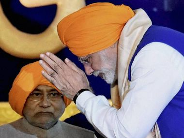 File image of Narendra Modi and Nitish Kumar. PTI