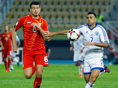 File image of Macedonia's Vance Sikov in action with Israel's Eran Zahavi. Reuters