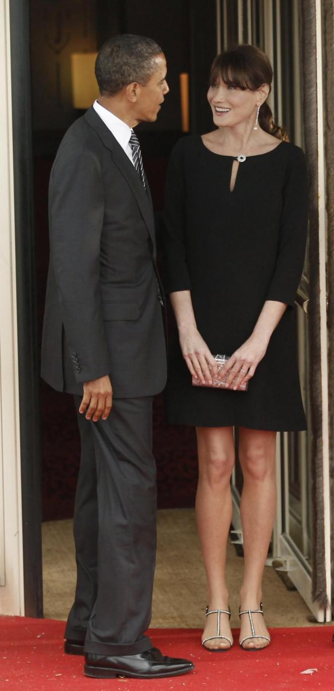 U.S. President Barack Obama is greeted by Carla Bruni-Sarkozy in Deauville