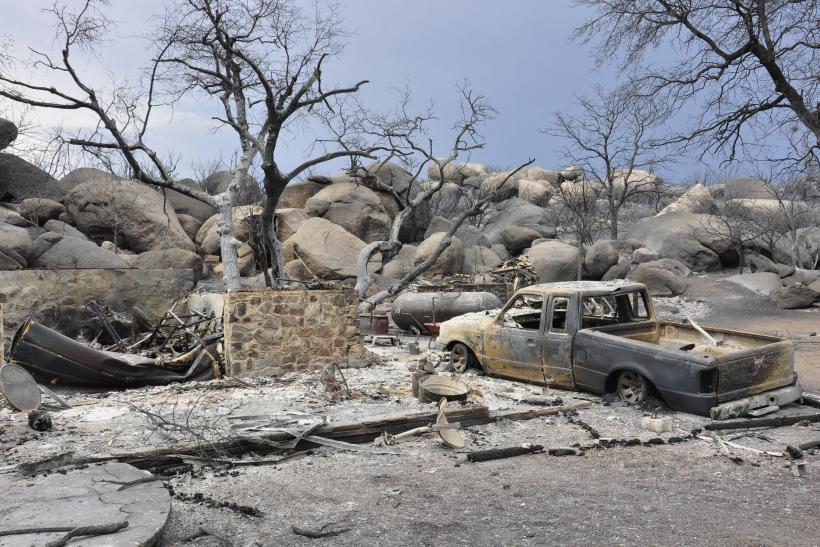 A burned home is seen in an unidentified neighborhood west of Highway 89 in Yarnell, Arizona July 3, 2013. Reuters
