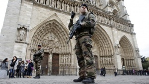 Soldiers patrol in front of the Notre Dame Cathedral in Paris, France, November 16, 2015, as security increases in the French capital after last Friday's series of deadly attacks. REUTERS/Charles Platiau