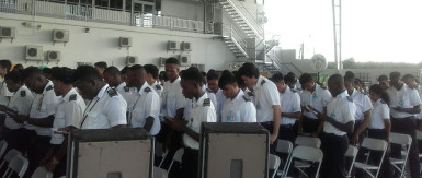 A section of the graduating class reciting the Mechanics Creed at their graduation at the Wings Aviation Ltd hangar, Ogle