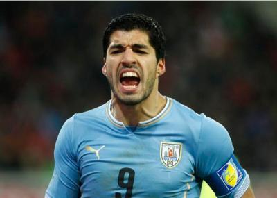 Uruguay'sSuarez reacts during their international friendly soccer match against Austria in Klagenfurt