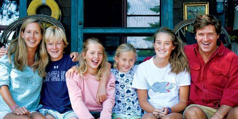 Tucker Carlson and wife Susan Andrews with their four children