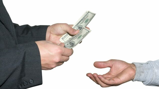 Outstretched Male Hand Accepting Dollars From Older Male Hands, Bank Of Mum And Dad Concept