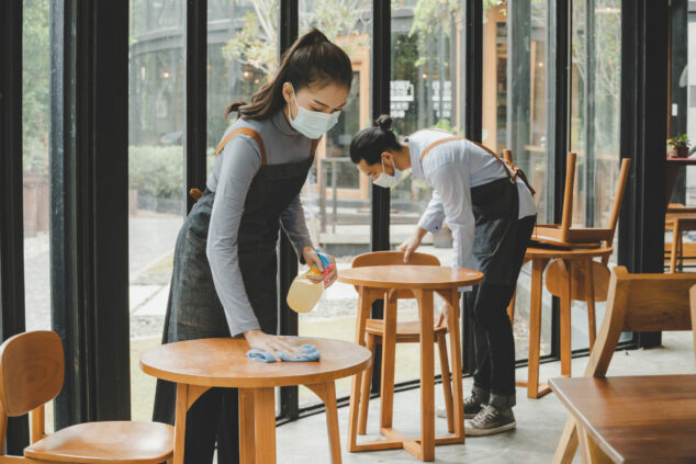 Waiters Cleaning Tables In Cafe, Covid Safe Concept