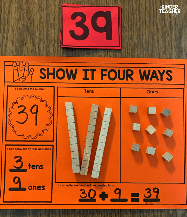 Orange worksheet with the number 39 represented as numerals, tens and ones, place value blocks, and 30+9