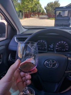 It's private property, so a glass of wine in the car is fine, perhaps encouraged!