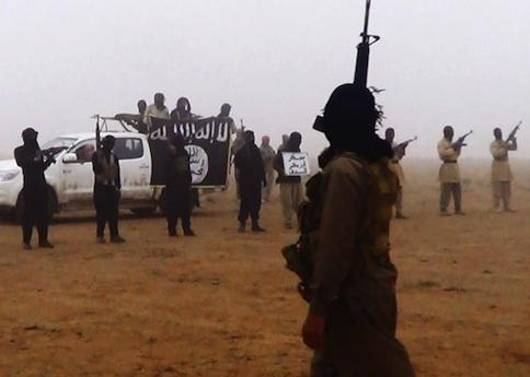 Al Qaeda militants in the al-Jazeera region on the Iraqi side of the Syria-Iraq border. / AP