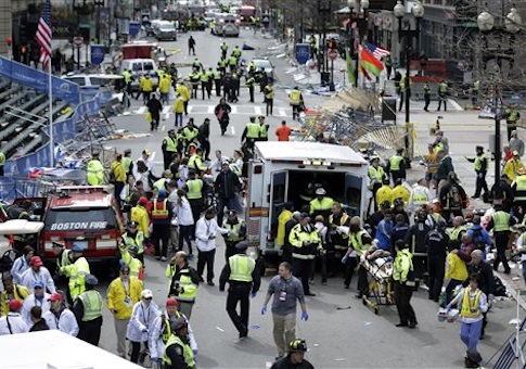 medical workers aid injured people near the finish line of the 2013 Boston Marathon following two bomb explosions