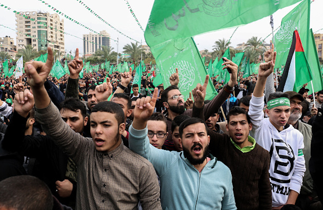 Palestinians attend a rally marking the 31st anniversary of Hamas' founding, in Gaza City