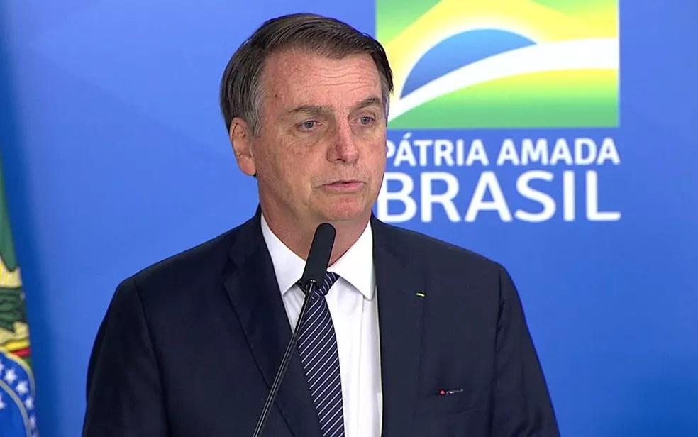 Presidente Jair Bolsonaro em entrevista coletiva para anunciar o decreto que acaba com o horário de verão nesta quinta-feira (25) — Foto: Reprodução/NBR