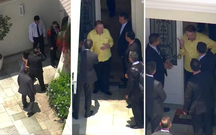 Jair Bolsonaro chega à casa de Silvio Santos (à esquerda); empresário sai à porta e conversa com outras pessoas da comitiva — Foto: TV Globo/Reprodução