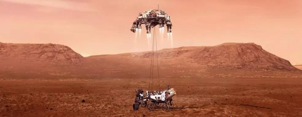 O robô descerá suspenso por cabos de náilon do 'guindaste' — Foto: EPA/Nasa/JPL-Caltech