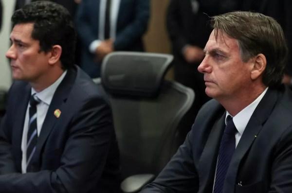 O presidente Jair Bolsonaro e o ministro Sérgio Moro, em maio deste ano, durante visita ao Centro Integrado de Inteligência e Segurança Pública da Região Sul, em Curitiba — Foto: Marcos Corrêa/PR