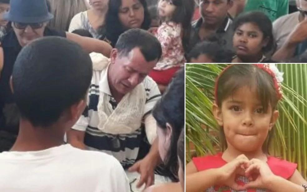 Pai se emociona durante velório da menina Júlia Rodrigues, em Goiânia (Foto: Renata Costa/TV Anhanguera)