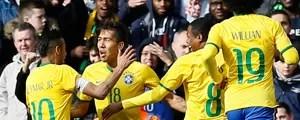 Brasil de Dunga segue invicto e bate o Chile por 1 a 0, gol de Firmino (Kirsty Wigglesworth/AP)