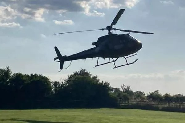 Tom Cruise's helicopter landing in Alison Webb's garden (Photo: personal archive)