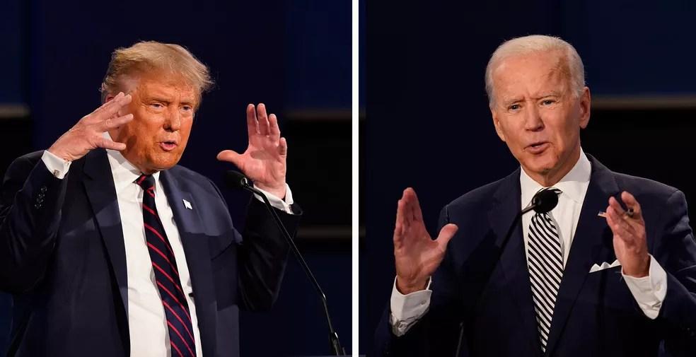 Presidente americano, Donald Trump, e o ex-vice-presidente Joe Biden durante o primeiro debate presidencial nesta terça-feira (29), em Cleveland, Ohio  — Foto: Patrick Semansky/AP