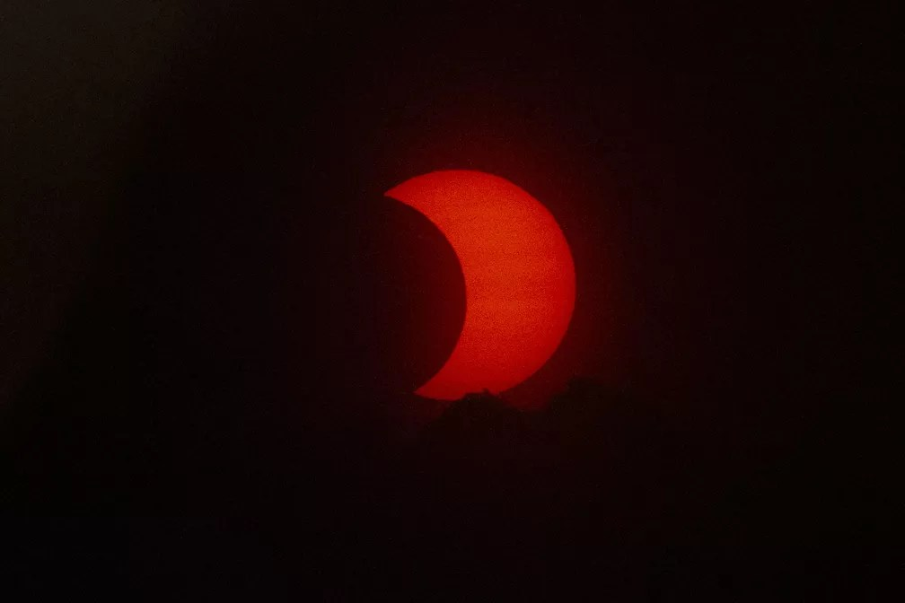 Eclipse solar anular visto de Jersey City, Nova Jersey — Foto: Kena Betancur/AFP