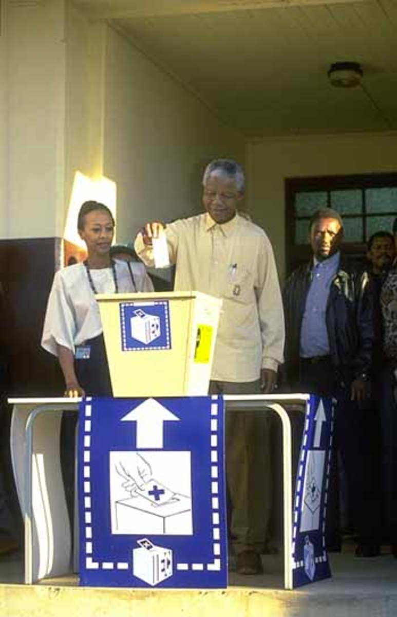 Nelson Mandela casting his vote for the first African government  in south Africa of which he became its first ever African President after 27 years in Robben Island Prison.