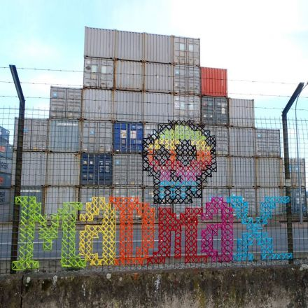 Urban X-Stitch: Street artist cross-stitches yarn on fences.