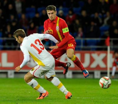 Wales' Ramsey is challenged by Macedonia's Ristovski during their 2014 World Cup qualifying soccer match in Cardiff, Wales