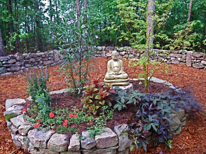 I was removing poison ivy from around a flower bed. I had two friends stop by one afternoon and they commented how nice it would be to have a stonewall behind my Buddha garden.