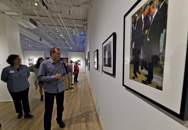 Pete Souza, former White House photographer for Ronald Reagan and Barack Obama, looks at his photographs hanging at the Sordoni Art Gallery at Wilkes University on Tuesday. Aimee Dilger | Times Leader