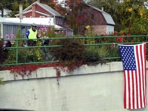 spencer-on-bridge-flag